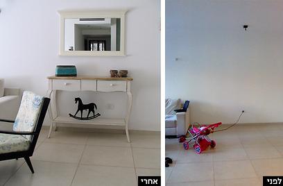מראה תלויה ושידת מגירות במראה משופשף מקשטות את קיר הכניסה לבית ()