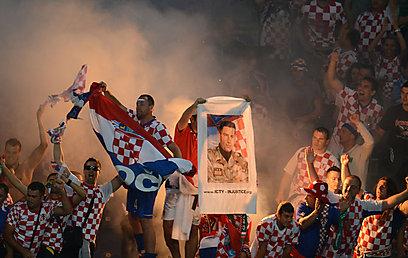 האוהדים נהנו ביציעים, בערך (צילום: AFP) (צילום: AFP)