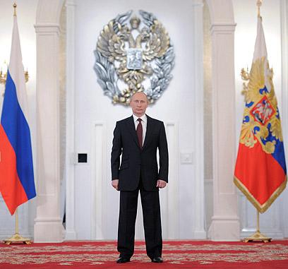 """פוטין. """"איש חזק"""" שיוביל את רוסיה בסבך המזימות הנרקמות סביבה (צילום: AFP) (צילום: AFP)"""