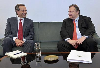 סמאראס בשיחות עם וניזלוס (צילום: רויטרס) (צילום: רויטרס)