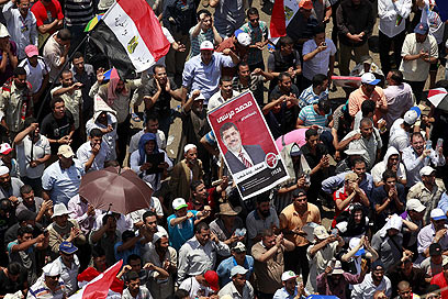 Morsi supporters in Cairo, Sunday (Photo: EPA)