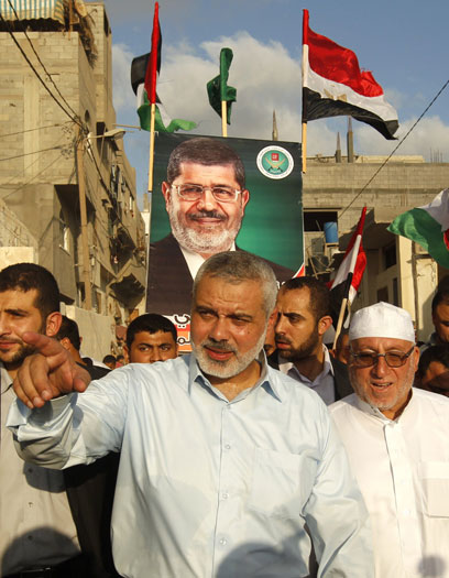 Haniyeh, Gazans celebrate Morsi win (Photo: AFP)