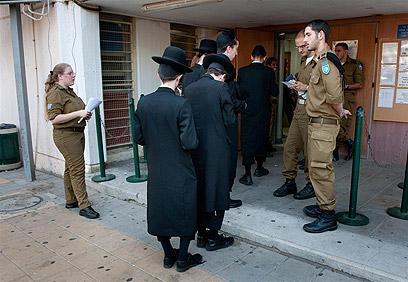Yeshiva students at IDF recruitment center. 'Women-free and secular-free' environment (Archive photo: Yaron Brener)