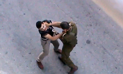 IDF officer headbutts Palestinian teen in July (Screenshot)