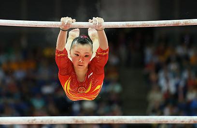 המתעמלת הסינית קצ'ין הא (צילום: EPA) (צילום: EPA)