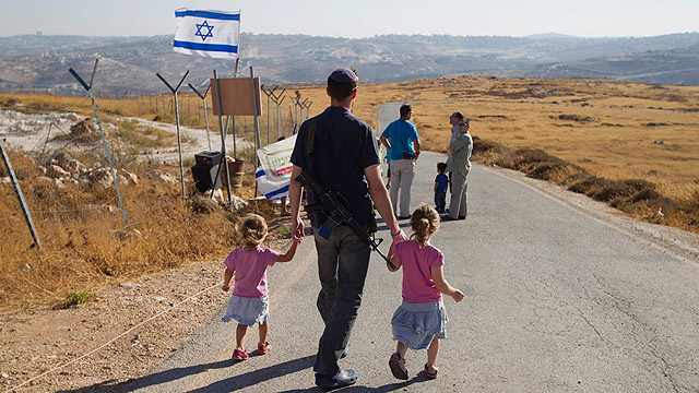 Israeli-Jewish settlers in Migron. The settlement project is heatedly debated inside Israel (Photo: Reuters)