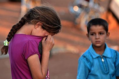 """יום אחד חמותי הגיעה אלינו עם בגדים חגיגיים לילדים, ואמרה: """"ילדים, הבאתי לכם בגדים לחתונה, בואו!"""" (אילוסטרציה: AFP) (צילום: AFP) (צילום: AFP)"""