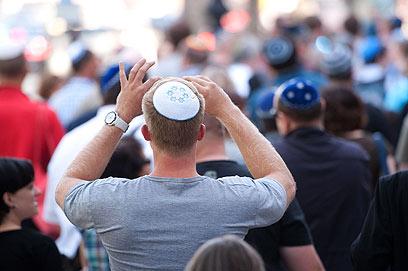 """משתתפים ב""""פלאשמוב כיפה"""". היום מתוכנן אירוע נוסף (צילום: AFP)"""