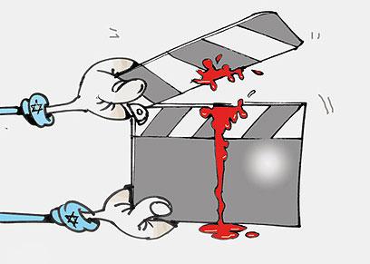 היד שאוחזת בסרט. מתוך העיתון האלג'יראי א-שורוק