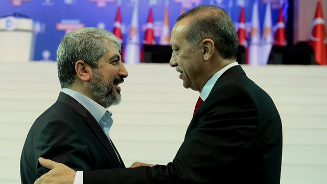 Hamas political leader Khaled Mashal, left, with Turkish President Erdogan in Turkey last year. (Photo: AP) (Photo: AP)
