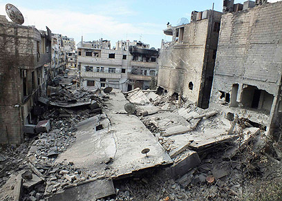 Devastation in Homs (Photo: Reuters)