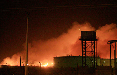 Sudan arms factory ablaze (Photo: Reuters)