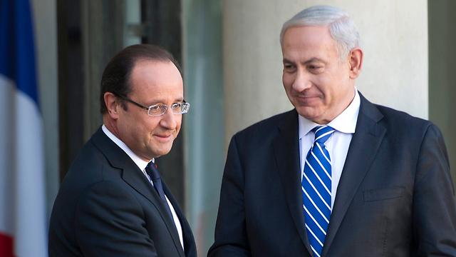 PM Netanyahu with President Hollande (Photo: EPA)
