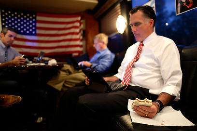 Romney on campaign bus (Photo: AP)