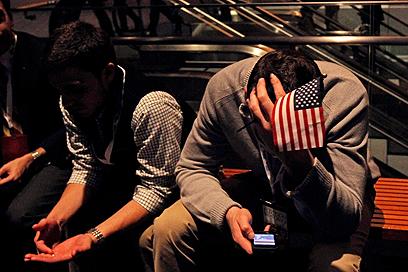 לא הלילה שלהם. תומכי רומני (צילום: AFP) (צילום: AFP)