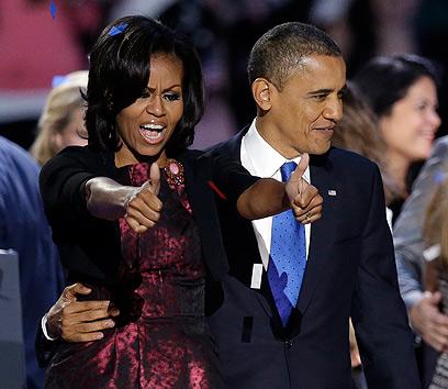 """""""מישל, מעולם לא אהבתי אותך יותר"""". הזוג אובמה (צילום: AP) (צילום: AP)"""
