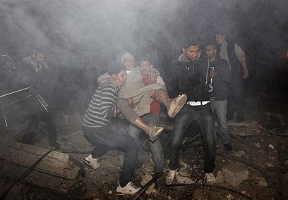 """צה""""ל תוקף בעזה (צילום: AFP) (צילום: AFP)"""