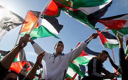 Palestinian celebration after UN status upgrade (Photo: AP)