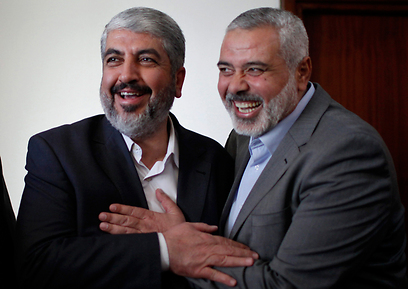 Mashal (left) with former Hamas prime minister Ismail Haniyeh (Photo: Reuters)