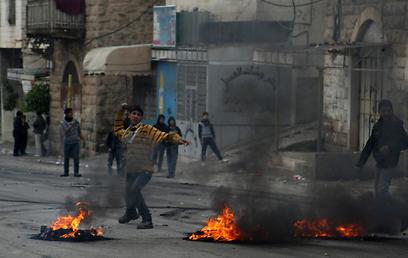 Riots in Hebron (Photo: AFP)