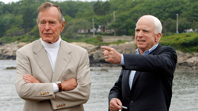 McCain with George H. W. Bush (Photo: Reuters)