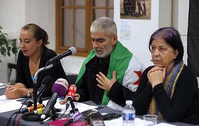 """אל-כרים, ביק ואל-חדרא. """"לא היינו עיתונאים"""" (צילום: AFP)"""