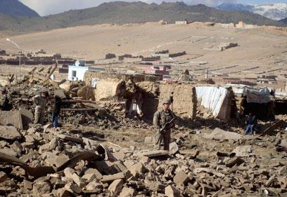 חייל אמריקני במחוז וורדאק באפגניסטן. הפנטגון משוכנע שהתוכניות יישאו פרי (צילום: AP) (צילום: AP)