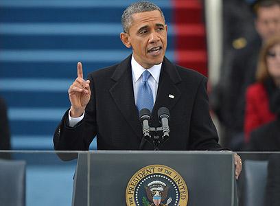"""אובמה בנאום ההשבעה. """"המדינה שלנו לא יכולה להצליח כשמיעוט הולך וקטן מצליח מאוד ורוב הולך וגדל בקושי מצליח"""" (צילום: AFP)"""