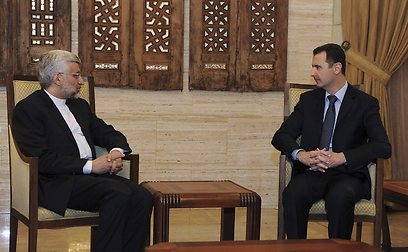 Assad with Iran's former secretary of the Supreme National Security Council Saeed Jalili (Photo: Reuters)