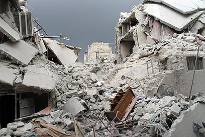 רובעים שלמים בחלב נהרסו בלחימה בחודשים האחרונים (צילום: רויטרס)