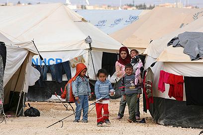 ילדים פליטים במחנה זעתרי (צילום: רויטרס) (צילום: רויטרס)