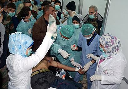 פצועים בחלב בחודש שעבר. דמשק טענה שהמורדים הם שהשתמשו בנשק כימי (צילום: EPA) (צילום: EPA)