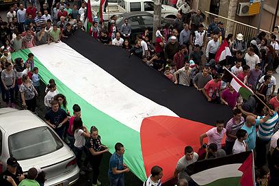 תהלוכת יום האדמה בסכנין (צילום: AFP) (צילום: AFP)