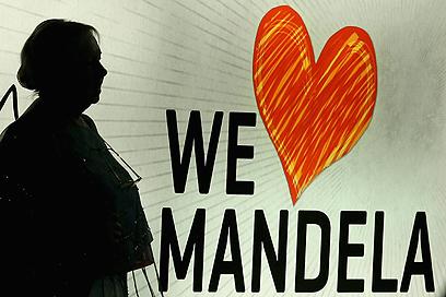 """""""אנחנו אוהבים את מנדלה"""" (צילום: Gettyimages)"""