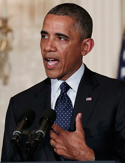 אובמה מודיע על פיטורי ראש רשות המסים. נפלא מול המיקרופון והמצלמה (צילום: רויטרס) (צילום: רויטרס)