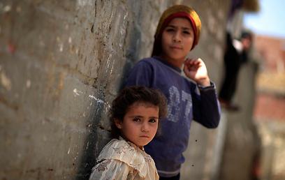 """פליטים פלסטינים. """"לא לכרוך את הפליטות"""" (צילום: AP) (צילום: AP)"""