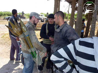 מאבק עז של המורדים בקוסייר (צילום: AP) (צילום: AP)