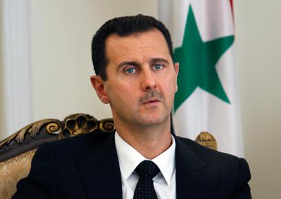 """נשיא סוריה אסד. הפעיל את """"יחידת הצבא הסורי האלקטרוני""""?  (צילום: AP) (צילום: AP)"""