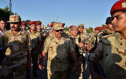 """""""איך יוכלו החיילים להצביע כשהם צריכים לאבטח את הקלפיות?"""" (צילום: AFP) (צילום: AFP)"""