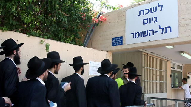 Haredim outside IDF recruitment center. In the not-so-distant future, nearly 50 percent of Israelis will be exempted from military service (Photo: Ofer Amram)  (Photo: Ofer Amram)