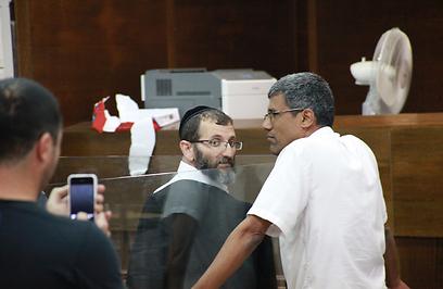 החשוד בבית המשפט (צילום: מוטי קמחי)
