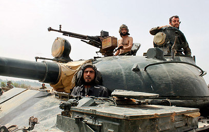 Syrian rebels near Qusair (Photo: Reuters) (Photo: Reuters)