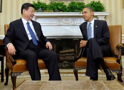אובמה ושי בפגישתם האחרונה בבית הלבן ב-2012 (צילום: AP) (צילום: AP)