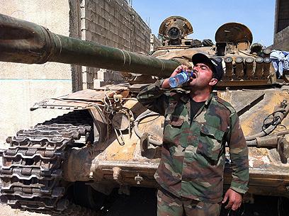 Syrian soldier in Qusair (Photo: AFP)