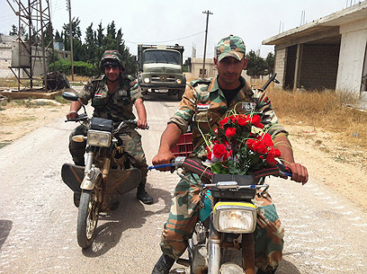 Syrian soldiers in Qusair (Photo: AFP)