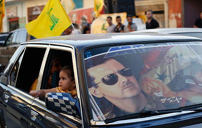 Hezbollah supporters celebrate victory in Qusair (Photo: Reuters)