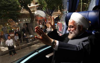 """ד""""ר למשפטים ועכשיו גם נשיא איראן. רוחאני בקמפיין הבחירות (צילום: AP) (צילום: AP)"""