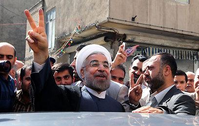כך ייעשה לאיש. נשיא איראן החדש, חסן רוחאני (צילום: AFP) (צילום: AFP)