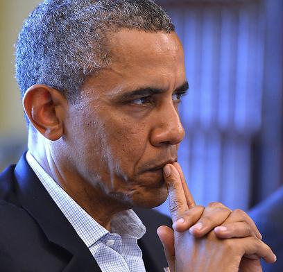 """""""מנהיג עולמי שמבצע הונאה"""". המדליף שולח מסר לאובמה (צילום: AFP)"""