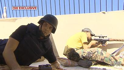 """""""הצלף אמר לי שהירייה סיימה את חייו של מורד סורי"""". כתב CNN פרדריק פלייטגן (צילום: CNN) (צילום: CNN)"""